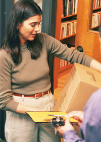 Photo: woman accepting delivery of package