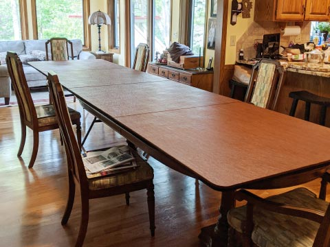 Photo: two tables extended into one long table using a cherry woodgrain extender
