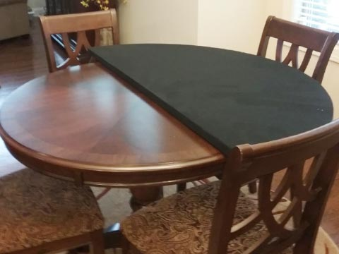 Photo: 54-inch card table extender folded in half to show fabric underside