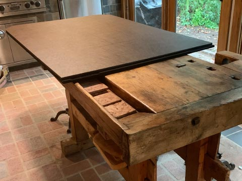 Kitchen table with walnut extender pad partly installed