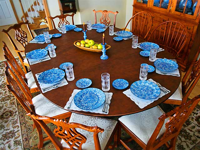 Dining table enlarged from six seats to ten seats with expansion pad